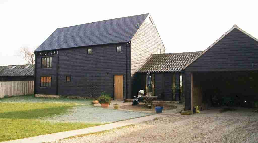 barn conversion black weatherboarding